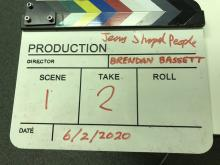 Photo of a clapperboard from Brendan's filming