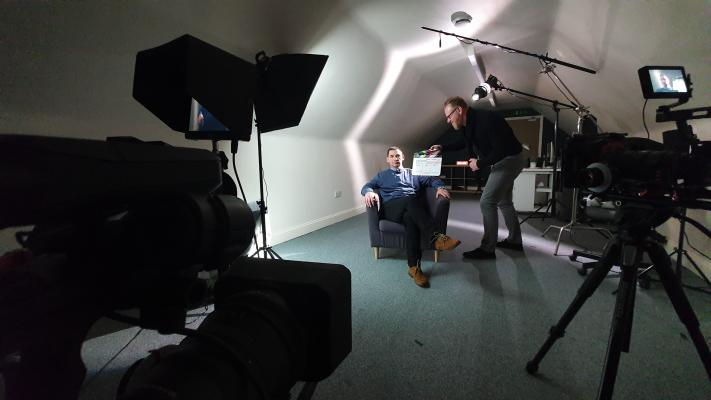 Photo of JSP team leader Brendan Bassett seated for a recording