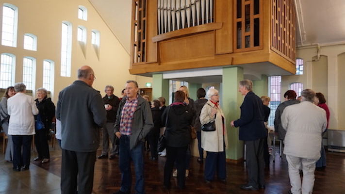 Photo of early arrivals chatting before the service